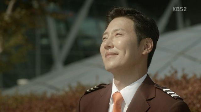 Beom-joon looking at planes with a smile